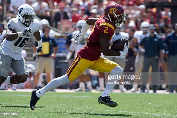 Adoree Jackson of the USC Trojans scores a touchdown with a 77 yard punt return in the 3rd quarter against the Utah State Aggies at Los Angeles...