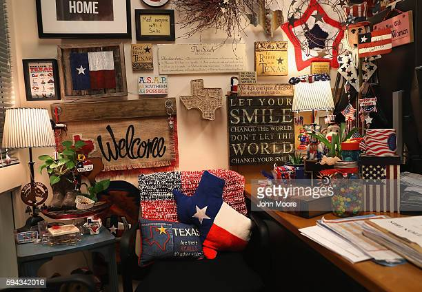 Adornments hang on the wall of a US Citizenship and Immigration Services officer in the Dallas Field Office on August 22 2016 in Irving Texas The...