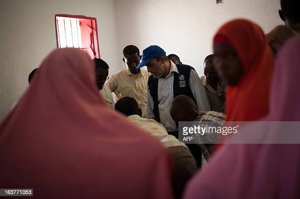 ADr Omar Saleh Emergency Coordinator for Somalia from the World Health Organisation examines a patient in Kismayo General Hospital in the city 500km...