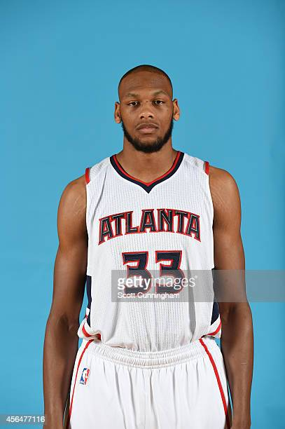 Adreian Payne of the Atlanta Hawks poses for a photograph during the Atlanta Hawks Media Day on September 29 2014 at Philips Arena in Atlanta Georgia...