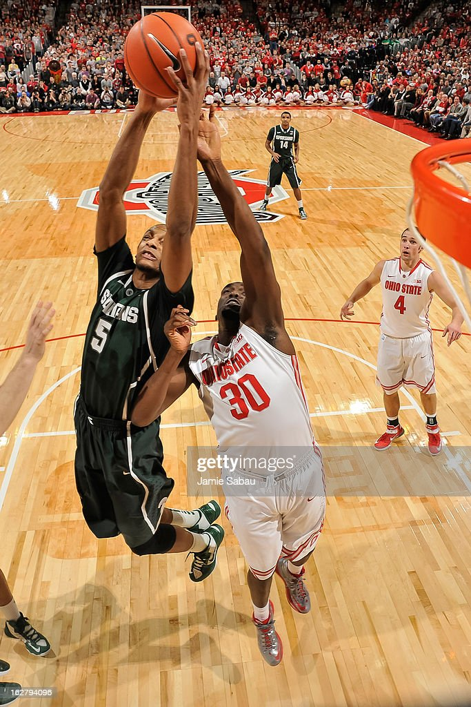 Adreian Payne #5 of the Michigan State Spartans and Evan Ravenel #30 of the Ohio State Buckeyes battle for control of a rebound on February 24, 2013 at Value City Arena in Columbus, Ohio.