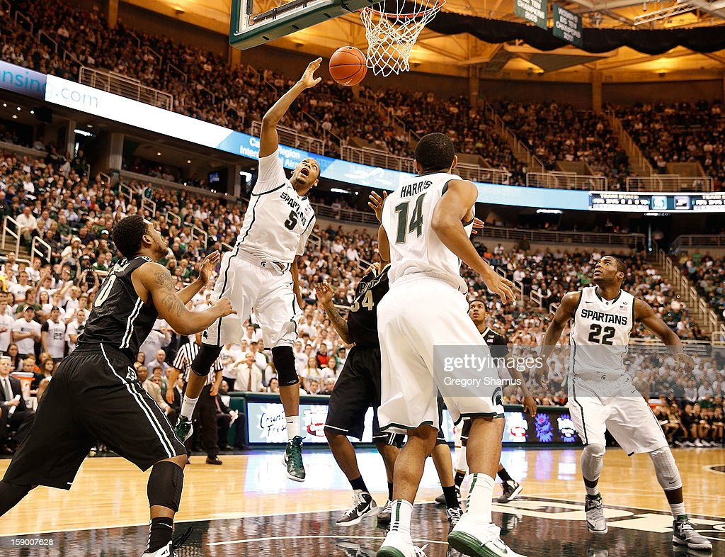 Adreian Payne #5 of the Michigan State Spartans battles for a second half rebound between Terone Johnson #0 and Jacob Lawson #34 of the Purdue Boilermakers at the Jack T. Breslin Student Events Center on January 5, 2013 in East Lansing, Michigan. Michigan State won the game 84-61.
