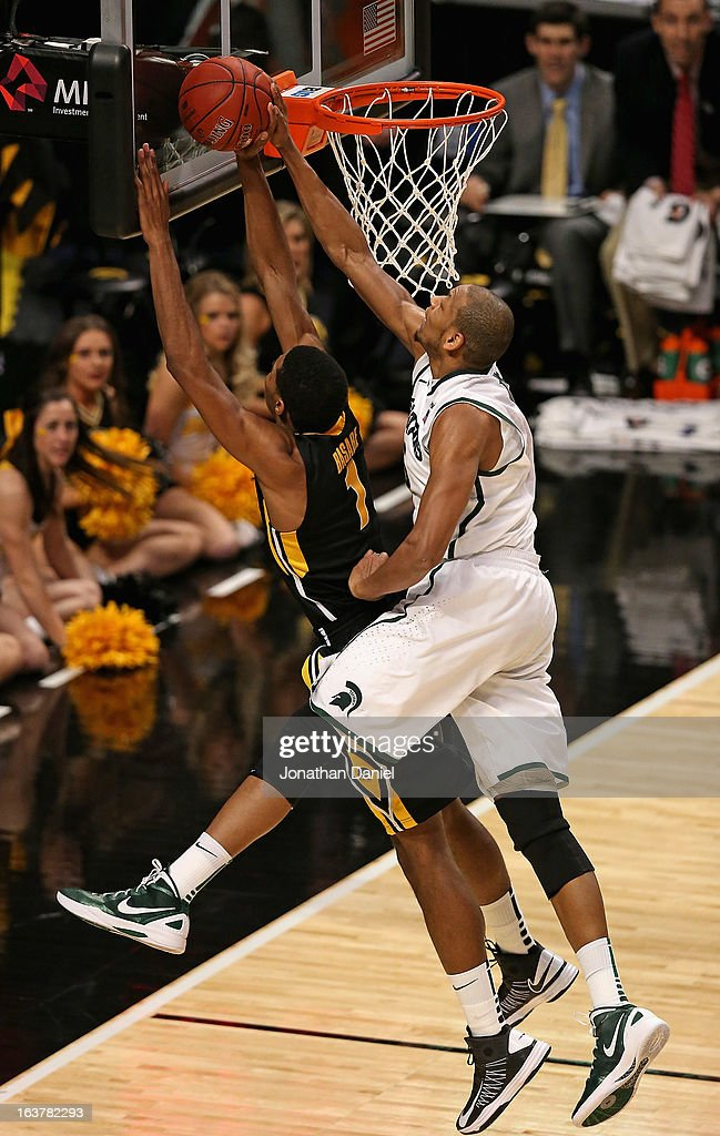 Adreian Payne #5 of the Michigan State Spartans blocks a shot by Melsahn Basabe #1 of the Iowa Hawkeyes during a quarterfinal game of the Big Ten Basketball Tournament at the United Center on March 15, 2013 in Chicago, Illinois. Michigan State defeats Iowa 59-56.