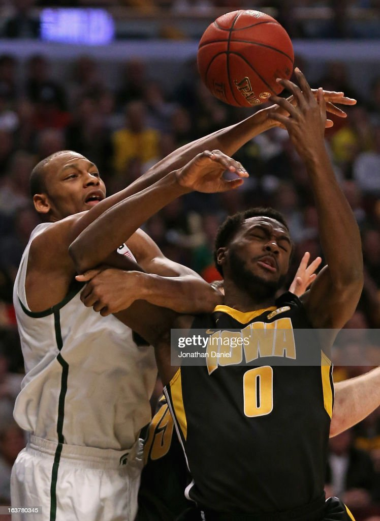 Adreian Payne #5 of the Michigan State Spartans causes Gabriel Olaseni #0 of the Iowa Hawkeyes to lose control of the ball during a quarterfinal game of the Big Ten Basketball Tournament at the United Center on March 15, 2013 in Chicago, Illinois.