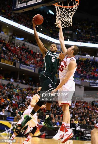 Adreian Payne of the Michigan State Spartans controls the ball against Sam Dekker of the Wisconsin Badgers during the first half of the Big Ten...