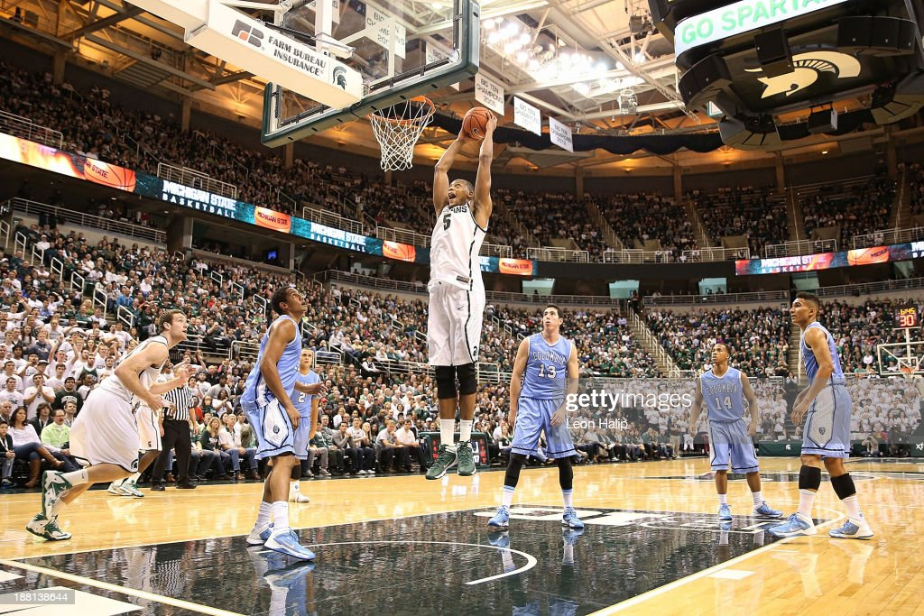Adreian Payne #5 of the Michigan State Spartans drives the ball to the basket during the first half of the game against the Columbia Lions at Breslin Center on November 15, 2013 in East Lansing, Michigan.