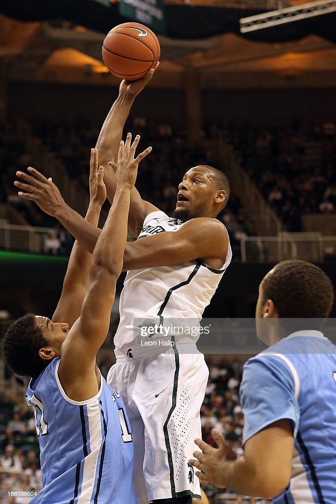 <a gi-track='captionPersonalityLinkClicked' href=/galleries/search?phrase=Adreian+Payne&family=editorial&specificpeople=7367769 ng-click='$event.stopPropagation()'>Adreian Payne</a> #5 of the Michigan State Spartans drives the ball to the basket during the second half of the game against the Columbia Lions at Breslin Center on November 15, 2013 in East Lansing, Michigan. Michigan State defeated Columbia 62-53.