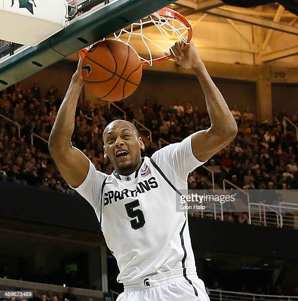 Adreian Payne of the Michigan State Spartans drives the ball to the basket during the second half of the game against the New Orleans Privateers at...
