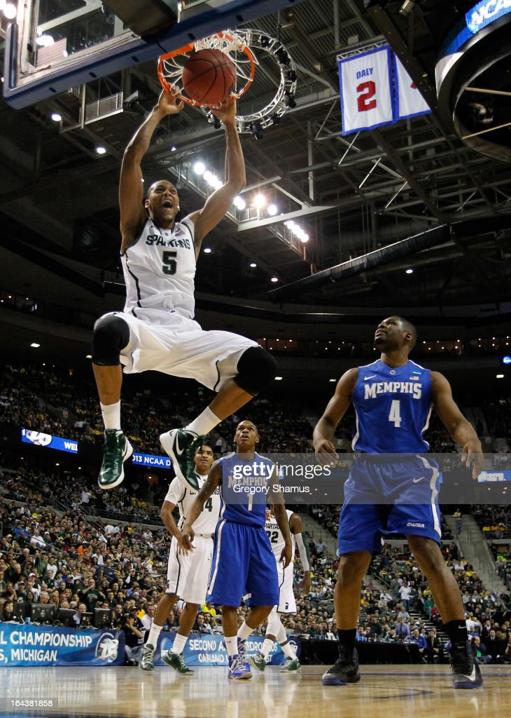 <a gi-track='captionPersonalityLinkClicked' href=/galleries/search?phrase=Adreian+Payne&family=editorial&specificpeople=7367769 ng-click='$event.stopPropagation()'>Adreian Payne</a> #5 of the Michigan State Spartans dunks in the first half against Adonis Thomas #4 of the Memphis Tigers during the third round of the 2013 NCAA Men's Basketball Tournament at The Palace of Auburn Hills on March 23, 2013 in Auburn Hills, Michigan.
