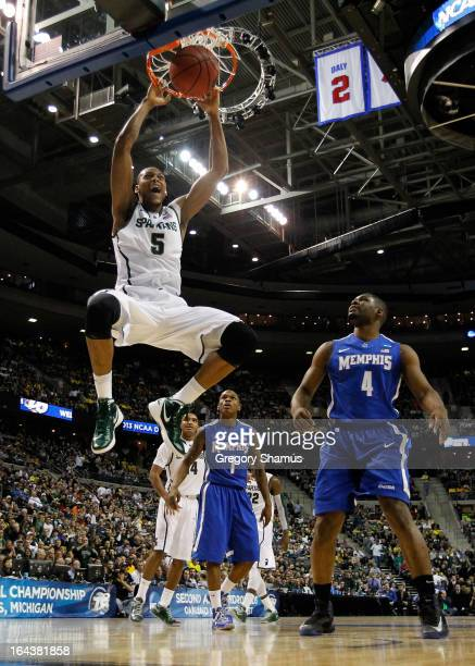 Adreian Payne of the Michigan State Spartans dunks in the first half against Adonis Thomas of the Memphis Tigers during the third round of the 2013...