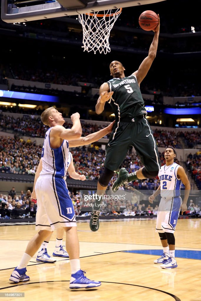 <a gi-track='captionPersonalityLinkClicked' href=/galleries/search?phrase=Adreian+Payne&family=editorial&specificpeople=7367769 ng-click='$event.stopPropagation()'>Adreian Payne</a> #5 of the Michigan State Spartans dunks in the first half against <a gi-track='captionPersonalityLinkClicked' href=/galleries/search?phrase=Mason+Plumlee&family=editorial&specificpeople=5792012 ng-click='$event.stopPropagation()'>Mason Plumlee</a> #5 of the Duke Blue Devils during the Midwest Region Semifinal round of the 2013 NCAA Men's Basketball Tournament at Lucas Oil Stadium on March 29, 2013 in Indianapolis, Indiana.