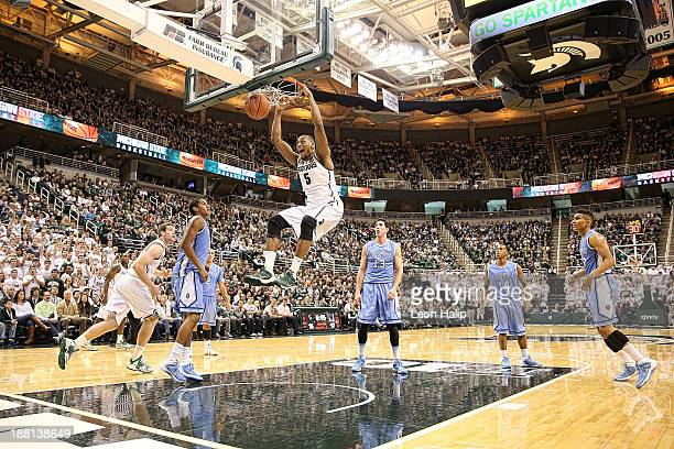 Adreian Payne of the Michigan State Spartans dunks the ball during the first half of the game against the Columbia Lions at Breslin Center on...