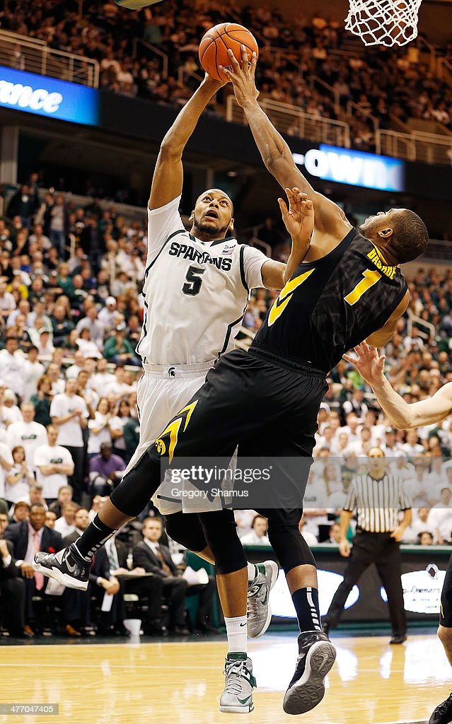 <a gi-track='captionPersonalityLinkClicked' href=/galleries/search?phrase=Adreian+Payne&family=editorial&specificpeople=7367769 ng-click='$event.stopPropagation()'>Adreian Payne</a> #5 of the Michigan State Spartans gets a second half shot blocked by Melsahn Basabe #1 of the Iowa Hawkeyes at the Jack T. Breslin Student Events Center on February 6, 2014 in East Lansing, Michigan. Michigan State won the game 86-76.