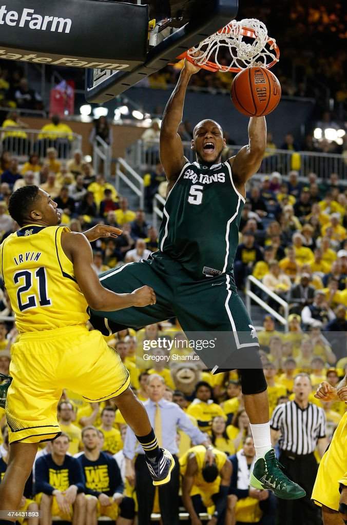 <a gi-track='captionPersonalityLinkClicked' href=/galleries/search?phrase=Adreian+Payne&family=editorial&specificpeople=7367769 ng-click='$event.stopPropagation()'>Adreian Payne</a> #5 of the Michigan State Spartans gets in for a first half dunk next to Zak Irvin #21 of the Michigan Wolverines at Crisler Center on February 23, 2014 in Ann Arbor, Michigan.
