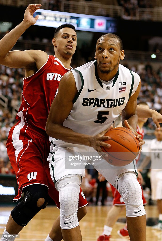 Adreian Payne #5 of the Michigan State Spartans looks to get a second half shot off around Ryan Evans #5 of the Wisconsin Badgers at the Jack T. Breslin Student Events Center on March 7, 2013 in East Lansing, Michigan. Michigan State won the game 58-43.