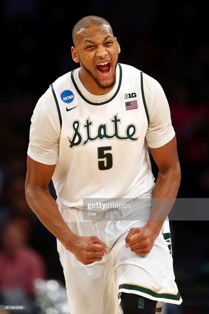 <a gi-track='captionPersonalityLinkClicked' href=/galleries/search?phrase=Adreian+Payne&family=editorial&specificpeople=7367769 ng-click='$event.stopPropagation()'>Adreian Payne</a> #5 of the Michigan State Spartans reacts after a basket in the second half against the Connecticut Huskies during the East Regional Final of the 2014 NCAA Men's Basketball Tournament at Madison Square Garden on March 30, 2014 in New York City.