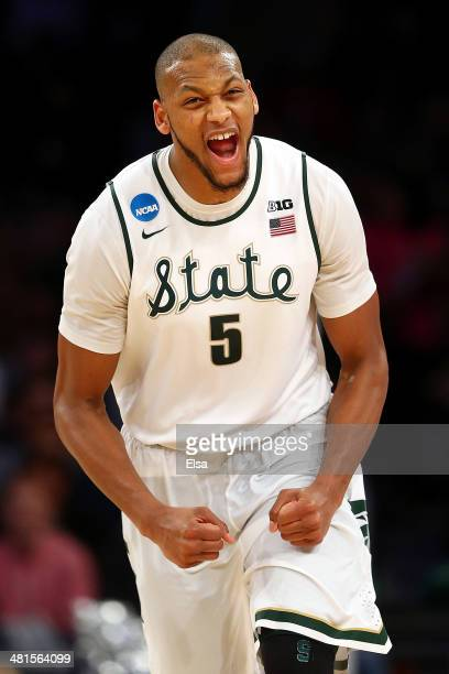 Adreian Payne of the Michigan State Spartans reacts after a basket in the second half against the Connecticut Huskies during the East Regional Final...