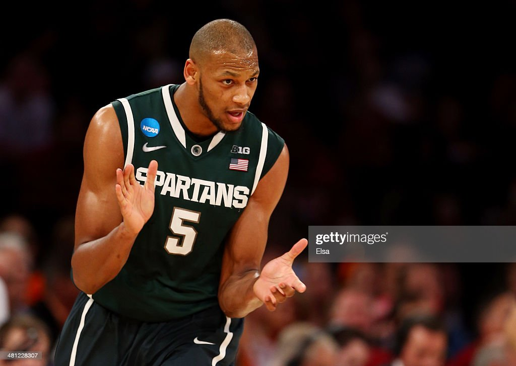 <a gi-track='captionPersonalityLinkClicked' href=/galleries/search?phrase=Adreian+Payne&family=editorial&specificpeople=7367769 ng-click='$event.stopPropagation()'>Adreian Payne</a> #5 of the Michigan State Spartans reacts after a basket against the Iowa State Cyclones during the regional semifinal of the 2014 NCAA Men's Basketball Tournament at Madison Square Garden on March 28, 2014 in New York City.