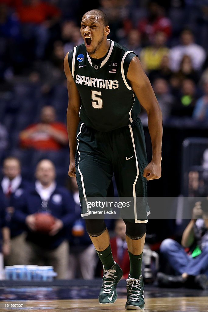 <a gi-track='captionPersonalityLinkClicked' href=/galleries/search?phrase=Adreian+Payne&family=editorial&specificpeople=7367769 ng-click='$event.stopPropagation()'>Adreian Payne</a> #5 of the Michigan State Spartans reacts after he made a shot in the first half againnst the Duke Blue Devils during the Midwest Region Semifinal round of the 2013 NCAA Men's Basketball Tournament at Lucas Oil Stadium on March 29, 2013 in Indianapolis, Indiana.