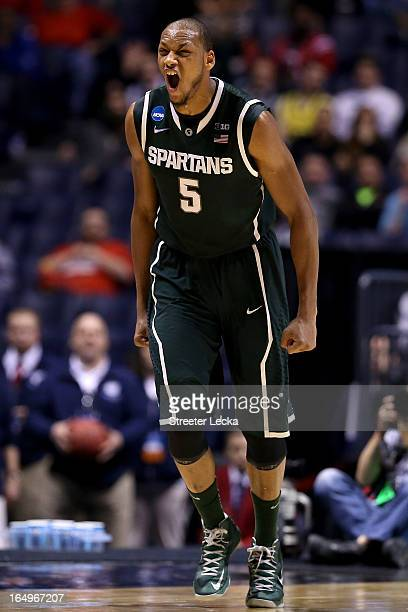 Adreian Payne of the Michigan State Spartans reacts after he made a shot in the first half againnst the Duke Blue Devils during the Midwest Region...