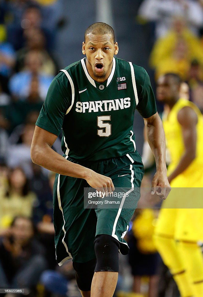 Adreian Payne #5 of the Michigan State Spartans reacts after making a first half three point shot while playing the Michigan Wolverines at Crisler Center on March 3, 2013 in Ann Arbor, Michigan.