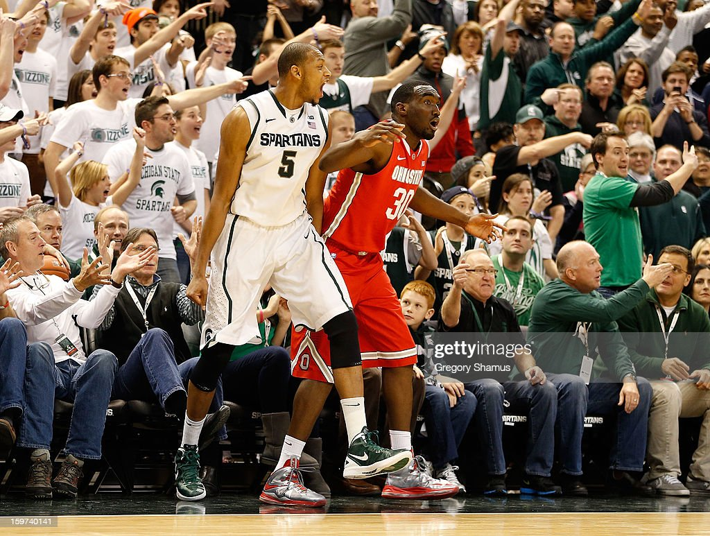Adreian Payne #5 of the Michigan State Spartans reacts next to Evan Ravenel #30 of the Ohio State Buckeyes in the second half at the Jack Breslin Center on January 19, 2013 in East Lansing, Michigan. Michigan State won the game 59-56.
