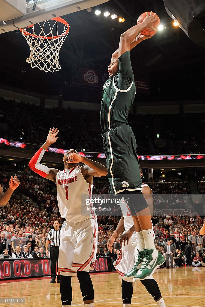 Adreian Payne #5 of the Michigan State Spartans slam dunks the ball over Deshaun Thomas #1 of the Ohio State Buckeyes on February 24, 2013 at Value City Arena in Columbus, Ohio.