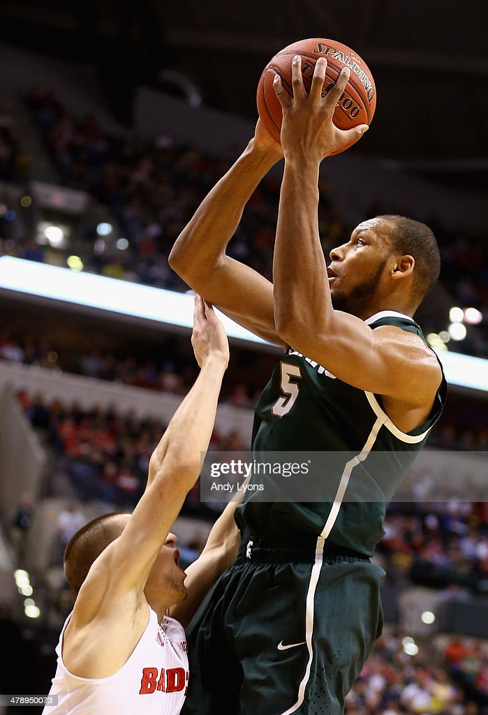 <a gi-track='captionPersonalityLinkClicked' href=/galleries/search?phrase=Adreian+Payne&family=editorial&specificpeople=7367769 ng-click='$event.stopPropagation()'>Adreian Payne</a> #5 of the Michigan State Spartans takes a shot against the Wisconsin Badgers during the second half of the Big Ten Basketball Tournament Semifinal game at Bankers Life Fieldhouse on March 15, 2014 in Indianapolis, Indiana.
