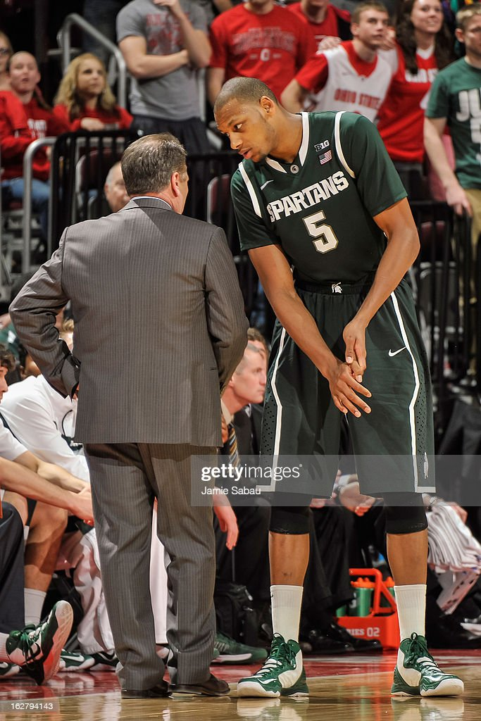 Adreian Payne #5 of the Michigan State Spartans talks with Head Coach Tom Izzo during a game against the Ohio State Buckeyes on February 24, 2013 at Value City Arena in Columbus, Ohio.
