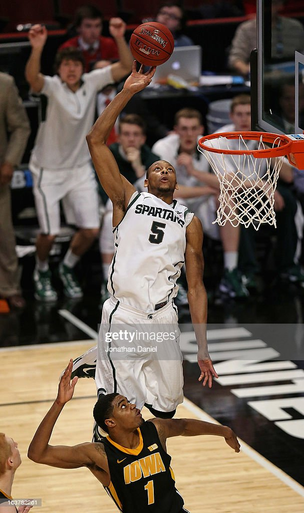 Adreian Payne #5 of the Michigan State Spartans tries to dunk and is fouled by Melsahn Basabe #1 of the Iowa Hawkeyes during a quarterfinal game of the Big Ten Basketball Tournament at the United Center on March 15, 2013 in Chicago, Illinois. Michigan State defeats Iowa 59-56.