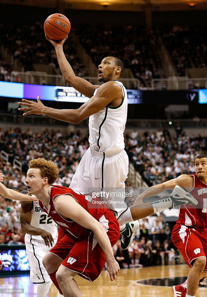 Adreian Payne #5 of the Michigan State Spartans tries to get a second half shot off over Mike Bruesewitz #31 of the Wisconsin Badgers at the Jack T. Breslin Student Events Center on March 7, 2013 in East Lansing, Michigan. Michigan State won the game 58-43.
