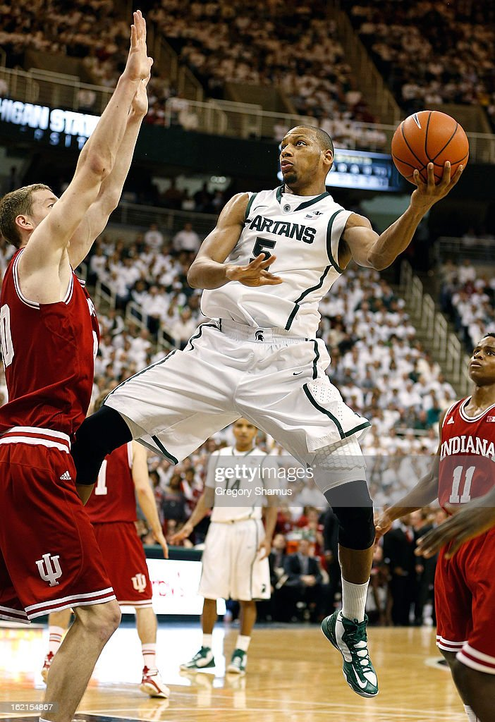 Adreian Payne #5 of the Michigan State Spartans tries to get off a second half shot around <a gi-track='captionPersonalityLinkClicked' href=/galleries/search?phrase=Cody+Zeller&family=editorial&specificpeople=7621233 ng-click='$event.stopPropagation()'>Cody Zeller</a> #40 of the Indiana Hoosiers at the Jack T. Breslin Student Events Center on February 19, 2013 in East Lansing, Michigan. Indiana won the game 72-68.