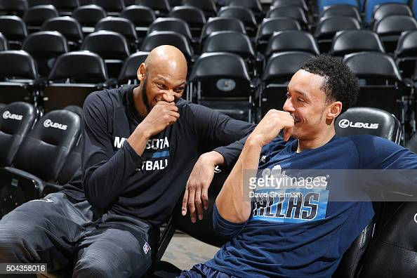 Adreian Payne of the Minnesota Timberwolves and John Jenkins of the Dallas Mavericks talk before the game on January 10 2016 at Target Center in...