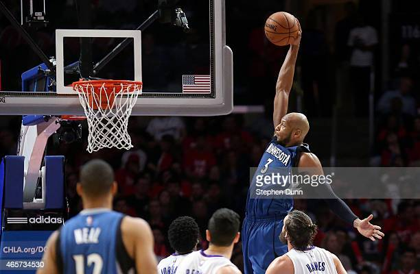 Adreian Payne of the Minnesota Timberwolves dunks against the Los Angeles Clippers at Staples Center on March 9 2015 in Los Angeles California The...