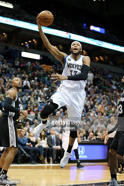 Adreian Payne of the Minnesota Timberwolves goes for the layup during the game against the San Antonio Spurs on March 8 2016 at Target Center in...