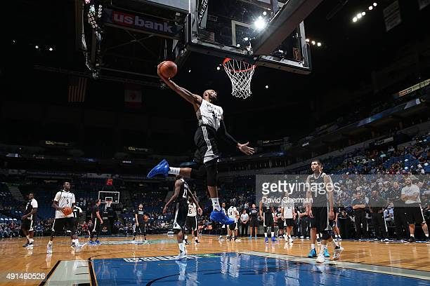 Adreian Payne of the Minnesota Timberwolves goes up for a dunk before a scrimmage on October 5 2015 at Target Center in Minneapolis Minnesota NOTE TO...