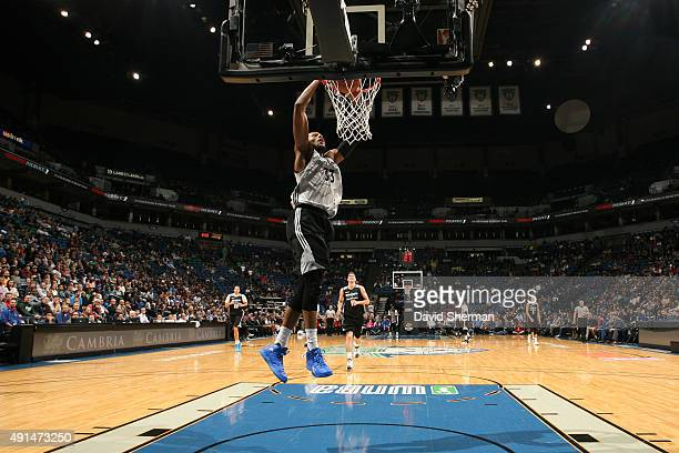 Adreian Payne of the Minnesota Timberwolves goes up for a dunk during a scrimmage on October 5 2015 at Target Center in Minneapolis Minnesota NOTE TO...