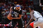 Adreian Payne of the Minnesota Timberwolves handles the ball against the Chicago Bulls during the 2016 NBA Las Vegas Summer League game on July 18...
