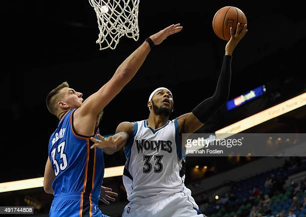 Adreian Payne of the Minnesota Timberwolves shoots a basket against Mitch McGary of the Oklahoma City Thunder during the fourth quarter of the...