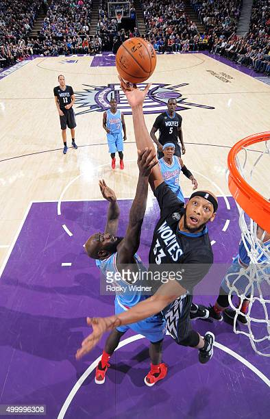 Adreian Payne of the Minnesota Timberwolves shoots against Quincy Acy of the Sacramento Kings on November 27 2015 at Sleep Train Arena in Sacramento...