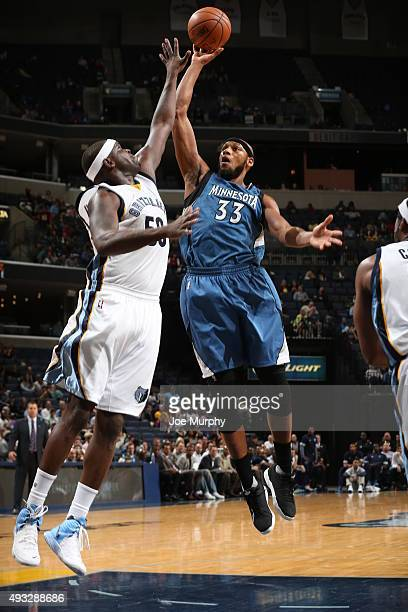Adreian Payne of the Minnesota Timberwolves shoots against Zach Randolph of the Memphis Grizzlies during the preseason game on October 18 2015 at...