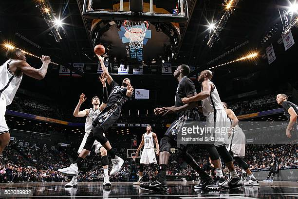 Adreian Payne of the Minnesota Timberwolves shoots the ball during the game against the Brooklyn Nets on December 20 2015 at Barclays Center in...