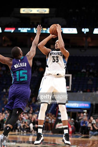 Adreian Payne of the Minnesota Timberwolves shoots the ball during the game against Kemba Walker of the Charlotte Hornets on November 15 2016 at...