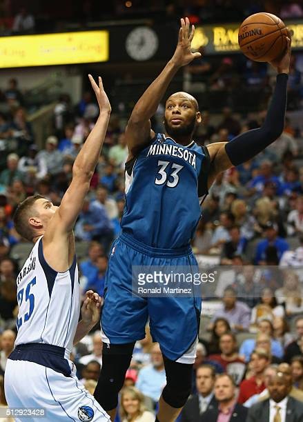 Adreian Payne of the Minnesota Timberwolves takes a shot against Chandler Parsons of the Dallas Mavericks at American Airlines Center on February 28...