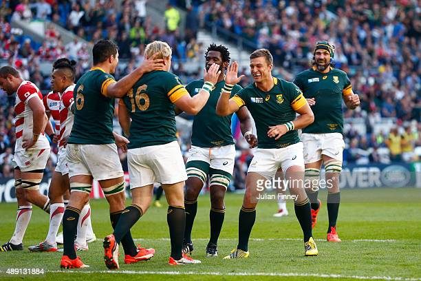 Adriaan Strauss of South Africa celebrates scoring his team's fourth try during the 2015 Rugby World Cup Pool B match between South Africa and Japan...
