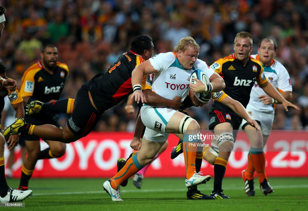 <a gi-track='captionPersonalityLinkClicked' href=/galleries/search?phrase=Adriaan+Strauss&family=editorial&specificpeople=675792 ng-click='$event.stopPropagation()'>Adriaan Strauss</a> of the Cheetahs is tackled by Pauliasi Manu of the Chiefs during the round three Super Rugby match between the Chiefs and the Cheetahs at Waikato Stadium on March 2, 2013 in Hamilton, New Zealand.