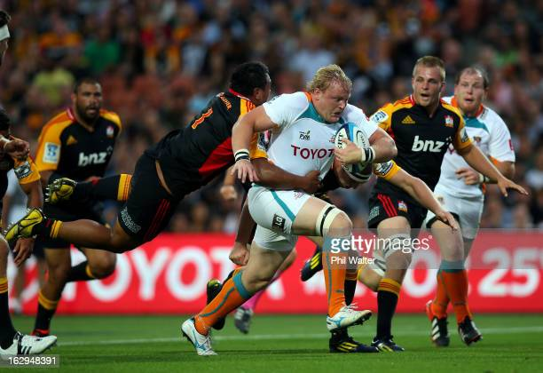 Adriaan Strauss of the Cheetahs is tackled by Pauliasi Manu of the Chiefs during the round three Super Rugby match between the Chiefs and the...