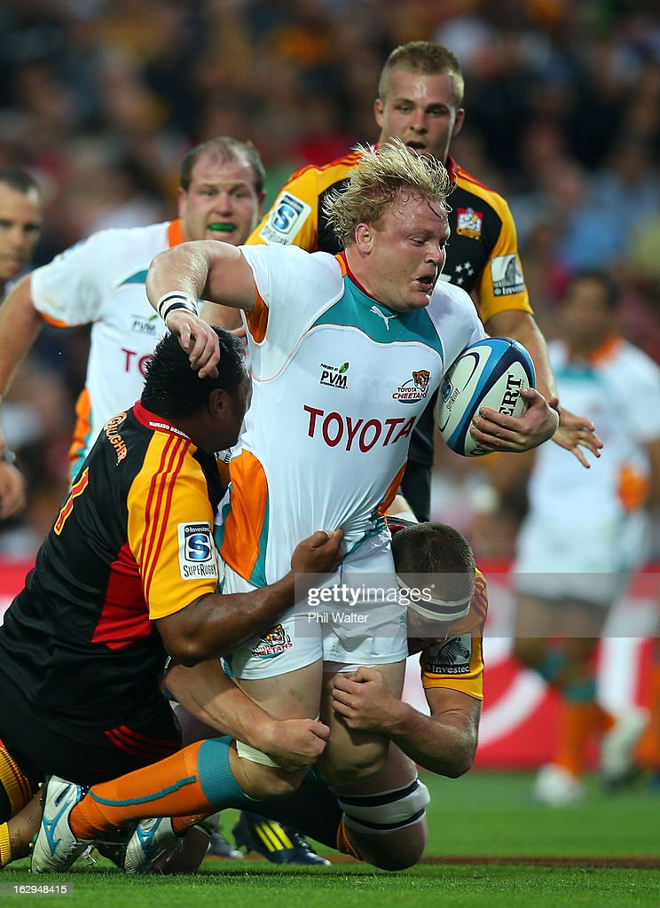 Adriaan Strauss of the Cheetahs is tackled by Pauliasi Manu of the Chiefs during the round three Super Rugby match between the Chiefs and the Cheetahs at Waikato Stadium on March 2, 2013 in Hamilton, New Zealand.