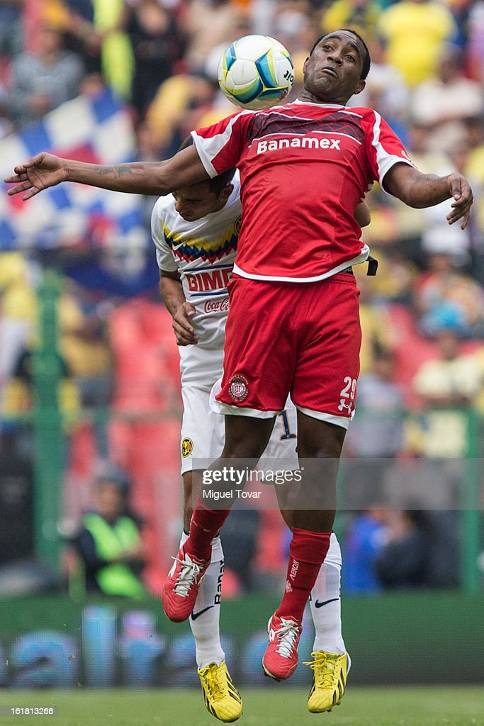 Adrian Alderete of America fights for the ball with Luis Tejada of Toluca during a Clausura 2013 Liga MX match between America and Toluca at Azteca Stadium on February 16, 2013 in Mexico City, Mexico.