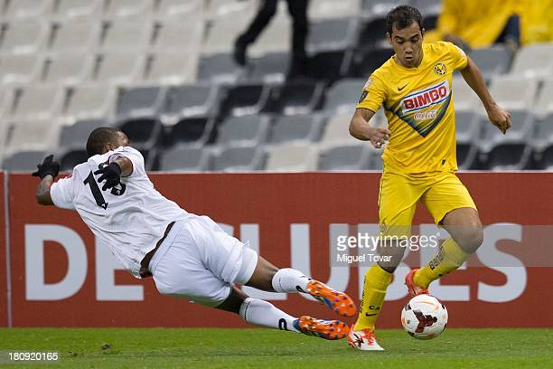 Adrian Alderete of Mexico's America fights for the ball with Miguel Olivares of Panama's Sporting San Miguelito during a match between America and...